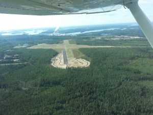 Immola Airport seen from runway 27 where there is a driving practice area. That wide asphalt is thus not part of the runway but is used for car driving practice. Photo: Jari Ruuskanen
