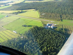 Field seen from the west side, from the beginning of runway 12. You can stay overnight for free on the couch in the cabin next to hangar. Photo Taken: 08.20.2015. Photo: Veikko Karasvirta