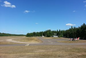 Kymi apron in the summer of 2013. The runway is located to the left and to the right is the taxiway to the hangars. Photo Esa Pirttinen. (Click to enlarge)