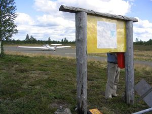 Airfield bulletin board, and a mailbox, where the guest book recides. Photo by Pekka Lehtinen (1.8.2005)
